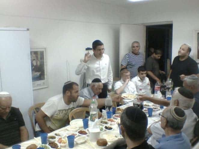 Nissim Cohen , a Moshav boy, speaking at a Moshav Siyum